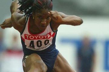 Denise Lewis in action over the hurdles in the women's heptathlon (Getty Images)