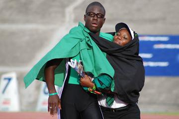 Ramone McKenzie celebrates with his mother after winning the 400m at the High School Boys & Girls Championships in March (Anthony Foster)