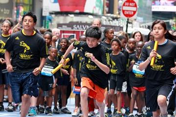 Taking to the streets in New York to celebrate the IAAF Centenary (Victah Sailer)