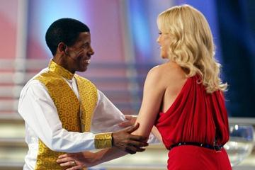 Haile Gebrselassie on stage with actress Charlize Theron at the FIFA draw in Cape Town (Getty Images)