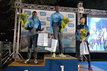 Refugee Athletes Domnic Lokinyomo Lobalu (c) and Paulo Amotun Lokoro (l) after their 1-2 finish in the Geneva 10km (Bernard Rono)