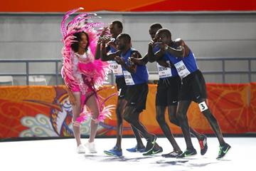 Members of the Athlete Refugee Team celebrate with a local dancer in Nassau (Getty Images)
