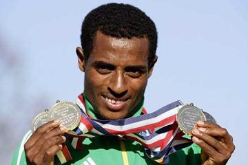 Kenenisa Bekele shows off his four gold medal haul (Getty Images)