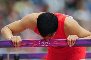 Xiang Liu of China kisses a hurdle after getting injured in the Men's 110m Hurdles Round 1 Heats on Day 11 of the London 2012 Olympic Games at Olympic Stadium on August 7 2012 (Getty Images)