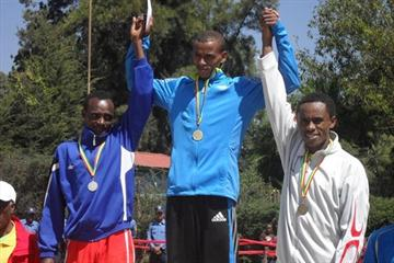 Men's podium at the Ethiopian XC Clubs Champs: Mesfin Haile, winner Bekana Daba and Feysa Lelisa (Bizuayehu Wagaw)