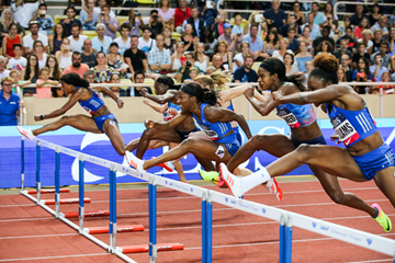 Kendra Harrison (centre) on her way to winning the 100m hurdles at the IAAF Diamond League meeting in Monaco (Philippe Fitte)