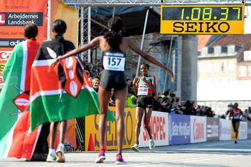 The three medallists await their teammates in the women's race at the IAAF World Half Marathon Championships Copenhagen 2014 (Getty Images)