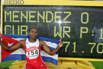 Osleidys Menendez poses in front of the World record board (Getty Images)