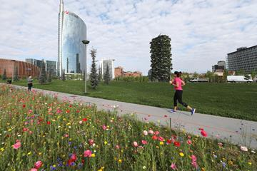 A runner at the reopening of the Biblioteca degli Alberi park in Milan as lockdown is relaxed on 4 May (Getty Images)