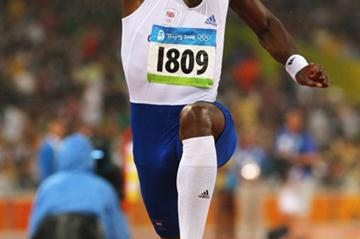 Phillips Idowu jumps to the silver medal in the Olympic triple jump final (Getty Images)