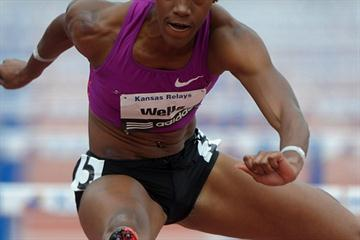 Kellie Wells en route to the 2011 Kansas Relays title (Kirby Lee)