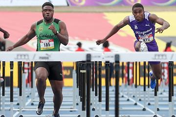 Wayne Pinnock (r) en route a meeting record at Jamaica's boys and girls champs in Kingston (Athelstan Bellamy)