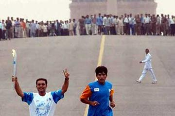 Olympic Torch relay in the streets of New Delhi in June 2004 (Getty Images)