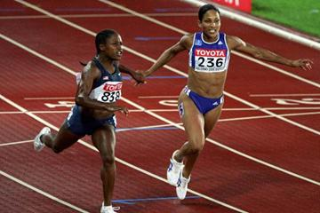 Lauryn Williams crosses the finish line in the women's 100m final (Getty Images)