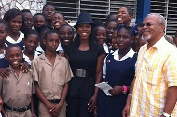 Veronica Campbell Brown (centre in hat) surrounded by students at St Andrew Technical while on a visit to Kingston in January 2012 (Veronica Campbell Brown)