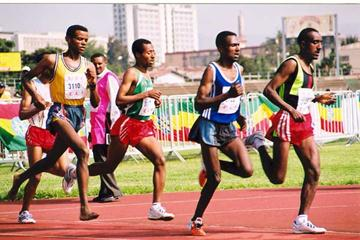 Sileshi Sihine (second from right) laps three runners in the men's 10,000m (Zenebework Bezabeh)