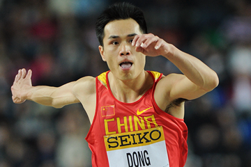 China's Dong Bin in action in the triple jump (AFP / Getty Images)