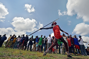 A Maasai warrior competes in the javelin at the Maasai Olympics (AFP / Getty Images)