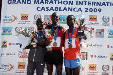 Kenyan Hillary Kipchumba atop the men's podium at the 2009 Casablanca Marathon - second was Sammy Rotich and Amos Matei Tirop (Freelance)
