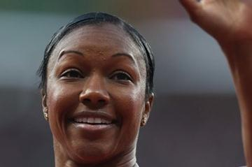 Carmelita Jeter of the United States waves after competes in the Women's 100m Semi Final on Day 8 of the London 2012 Olympic Games at Olympic Stadium on August 4, 2012 (Getty Images)