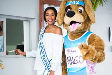 Miss Bahamas Ashley Hamilton and the relay's mascot, Bingo, purchase the first World Relays 2017 ticket (Bahamas 2017 LOC)
