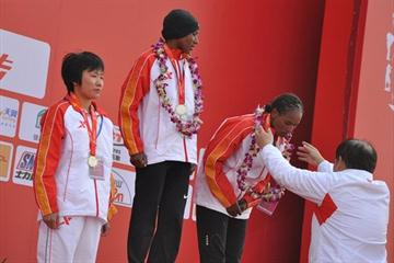 Women's podium in Xiamen – winner Amane Gobena (c), runner-up Alemitu Abera (r) and China's Wang Jiali (l) (Organisers)