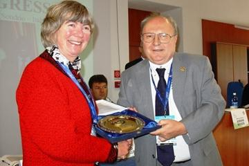Norma, widow of former WMRA President Danny Hughes, is presented with a Plaque of Merit by WMRA President Bruno Gozzelino in recognition of Danny's achievements for mountain running worldwide (WMRA)