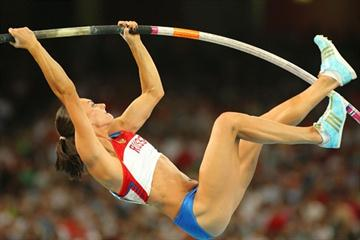 Yelena Isinbayeva improves her own world pole vault record to 5.05m to secure Olympic gold (Getty Images)