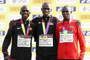 Men's senior race podium: silver medallist Jacob Kiplimo, winner Joshua Cheptegei and bronze medallist Geoffrey Kamworor at the IAAF/Mikkeller World Cross Country Championships Aarhus 2019 (Getty Images)