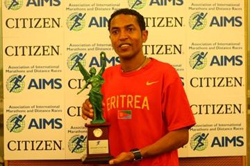 Zersenay Tadese receiving the AIMS/Citizen World's Fastest Time Award (Freelance)