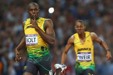 Usain Bolt of Jamaica celebrates in front of teammate Warren Weir of Jamaica after winning gold in the Men's 200m Final of the London 2012 Olympic Games on 9 August 2012 (Getty Images)