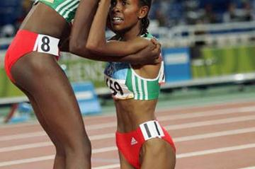 Meseret Defar is congratulated by Tirunesh Dibaba after winning the 5000m (Getty Images)