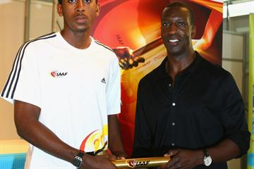 Michael Johnson (R) and Jehue Gordon attend the launch of the IAAF new logo (Getty Images)