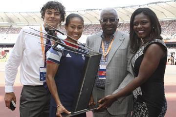 Shaun Campbell, Rachel Yankey, Lamine Diack and Dentaa Amoateng pose with Arthur Wharton Trophy at London's Olympic stadium, Saturday 27 July 2013 (Arthur Wharton Foundation)