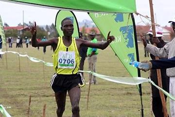 Timothy Kiptoo cuts the tape for victory in the senior men 12km race opening the 2010 KCC/AK Athletics Kenya National Cross Country Series in Tala, Kangundo (Njue Njagi, Ginadin Communications)