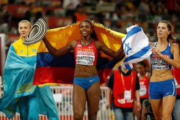 (L-R) Bronze medallist Olga Rypakova of Kazakhstan, gold medallist Caterine Ibarguen of Colombia, and silver medallist Hanna Minenko of Israel celebrate after the women's triple jump at the IAAF World Championships, Beijing 2015 (Getty Images)