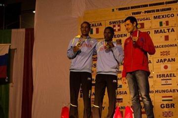 Men's podium at Ponte di Legno, from left: silver medallist Azeria Teklay, winner Petro Mamo, and bronze medallist Andrey Safranov (RUS) (WMRA)