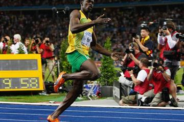 Usain Bolt of Jamaica crosses the line to win the gold medal in the men's 100 Men's 100m and sets another World Record in the process (Getty Images)