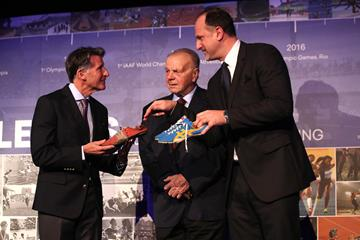 Father Janusz and son Andrzej Szewinski present Seb Coe with their wife and mother's spikes from 1960s and 1970s era. The latter are the spikes which Irena Szewinska wore when winning the 1976 Olympic Games 400m title (Giancarlo Colombo for the IAAF)