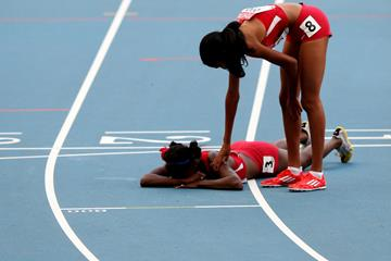 Ajee Wilson of the United States consoles Alysia Johnson Montano at the 2013 World Championships (Getty Images)