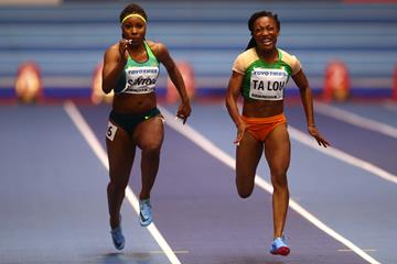 Marie-Josee Ta Lou (r) of Cote d'Ivoire and Rosangela Santos (l) of Brazil in the opening round of the women's 60m in Birmingham (Getty Images)