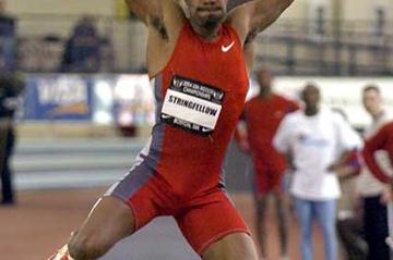 Savante Stringfellow leaps at the 2004 USATF Indoors (Kirby Lee)