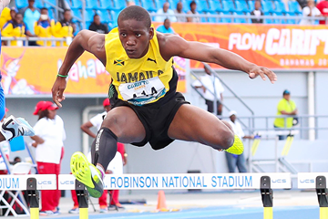 Rovane Williams on his way to winning the 400m hurdles at the Carifta Games (Leo Hudson)
