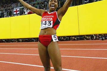 Perdita Felicien (CAN) celebrates winning the 60m Hurdles World title (Getty Images)