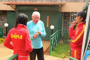 Italian distance-running coach Renato Canova speaks to two of the Chinese athletes in his training group (Jon Rosen)