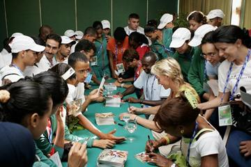 Heike Drechsler and Wilson Kipketer sign autographs during the Marrakech Class of Future Champions (Getty Images)
