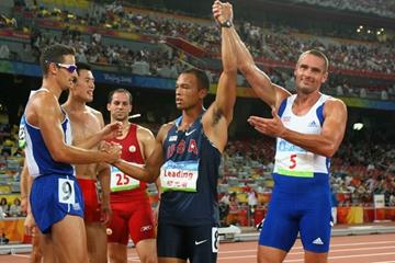 The changing of the guard: 2004 Olympic decathlon champion Roman Sebrle salutes the new champion, Bryan Clay (Getty Images)