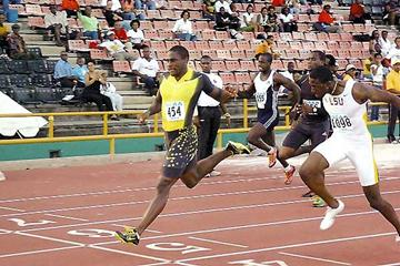 Darrel Brown, left, wins the Sagicor National Open Track and Field Championship men's 100 metres title, at the Hasely Crawford Stadium, on Saturday. Brown clocked a windy 9.88 seconds. Richard Thompson, right, earned silver in 9.95. (Dexter Philip – Trinidad Express)