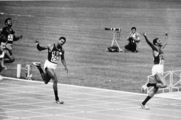 Tommie Smith (r) wins the 1968 Olympic 200m title with a 19.83 world record (Getty Images)