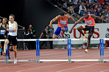 Kyron McMaster (right) on his way to winning the 400m hurdles at the IAAF Diamond League final in Zurich (Mark Shearman)